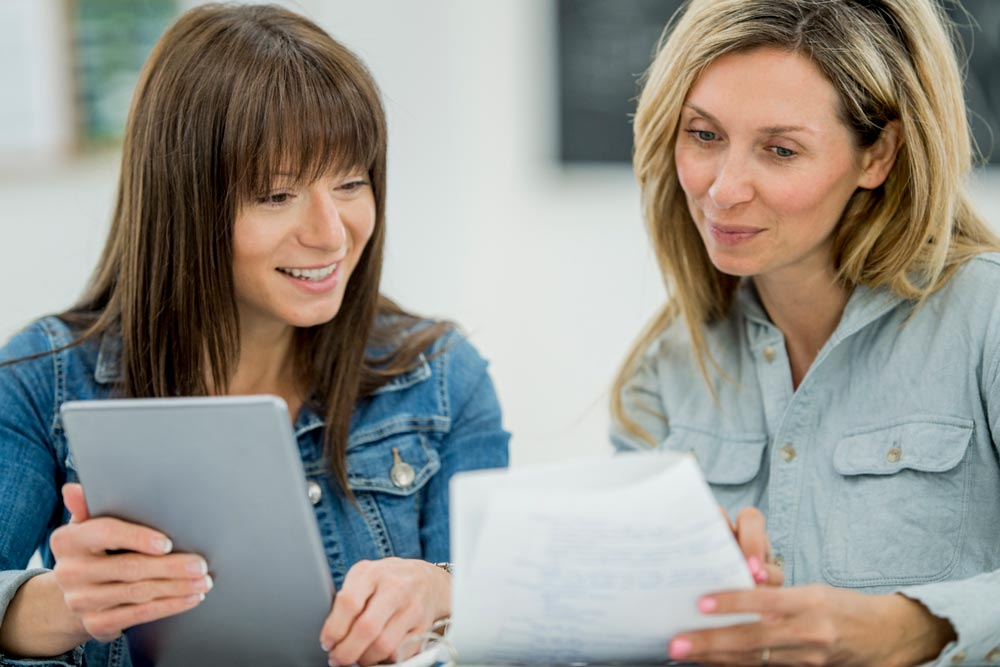 altura-two-women-ipads-chat